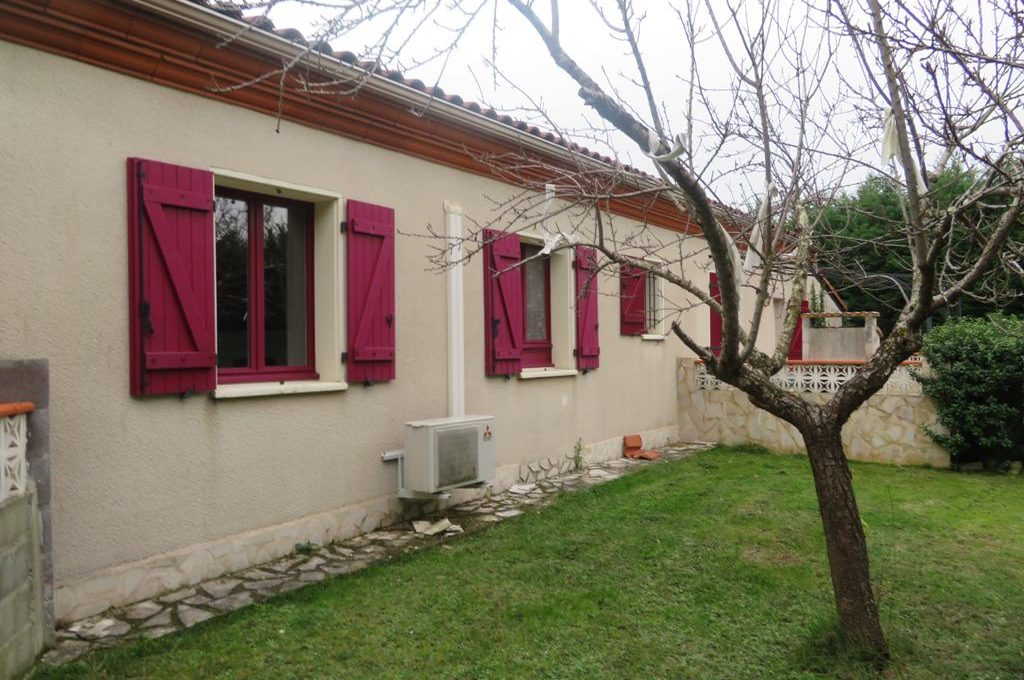 is-003-maison-st lys-facade-jardin-cote
